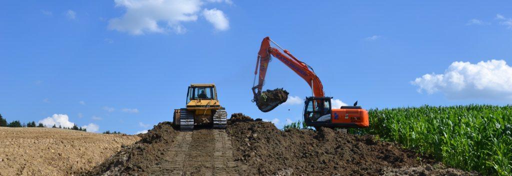 Erdbau Bagger Raupe Erdarbeiten Erde Schotter Kies Sand Materialien Aushub